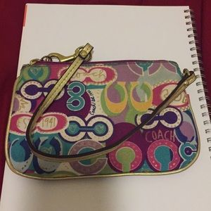 Coach mini purse with repositionable strap
